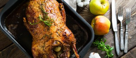Roasted goose with apples in a rustic style